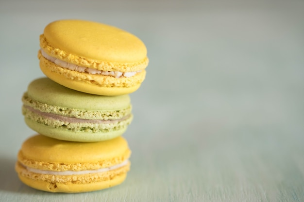 Tower from macarons on blue wooden table