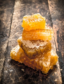 Tower of honeycomb. on the wooden background.