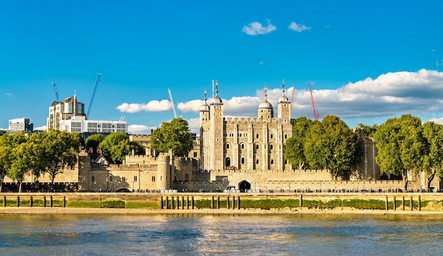 The tower of london, a historic castle on a bank of the thames river
