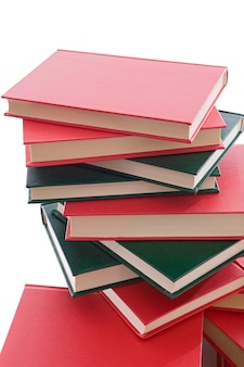 Tower of red and green books on a white background