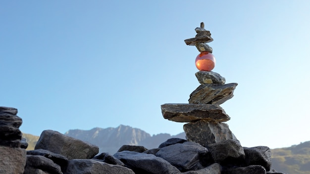 Tower of stones in balance (rock balance) with a crystal sphere holding the upper stones.
