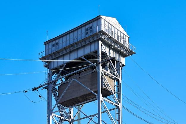 Tower of two-tier vertical lift bridge