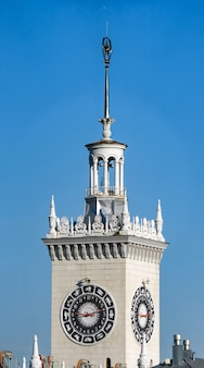 Tower with clock of the railway station in sochi. it was built in 1952, sochi, russia.