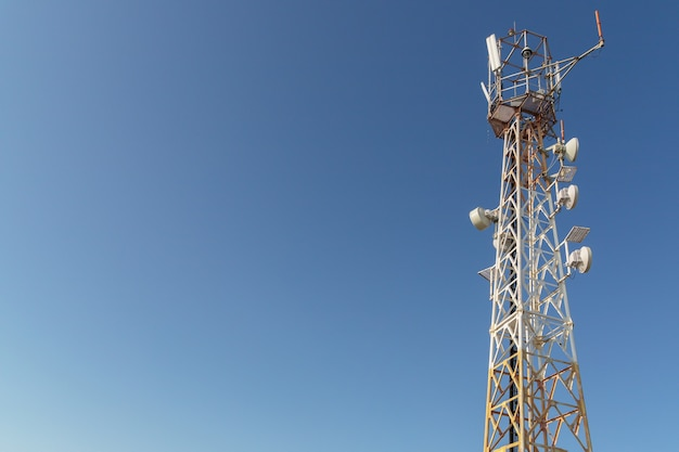 Tower with mobile operator antennas  on the background sky, 5g, 4g, mobile technologies, new generation communications