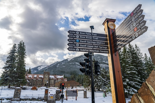 Town of banff street signpost in snowy autumn banff national park canadian rockies banff canada