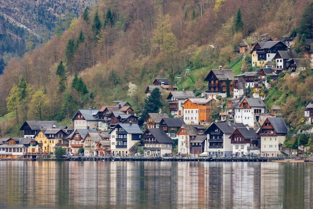 Town hallstatt with mountain lake and salt mines. alpine massif, beautiful canyon in austria. salzburg alpine valley in summer, clear water. destination for vacation, hiking and relaxation.