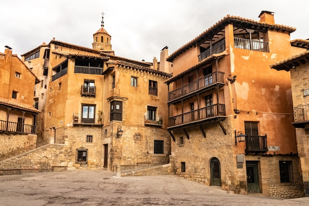 Town square with old stone houses in medieval style, balconies and windows. albarracã­n teruel spain. europe.