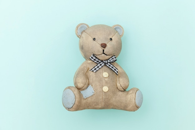 Toy bear isolated on pastel blue