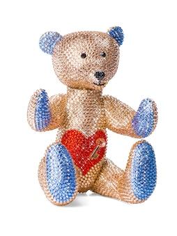 白い背景の上のラインストーンとクリスタルで作られたおもちゃのクマ