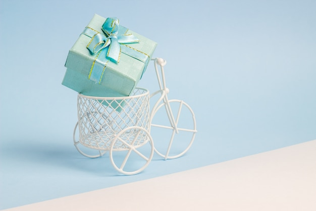 A toy bike carries a gift.