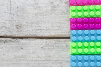 Toy bricks on wooden surface