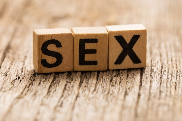 Toy bricks on the table with word sex