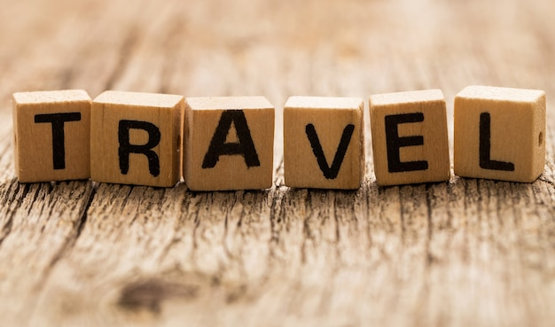 Toy bricks on the table with word travel