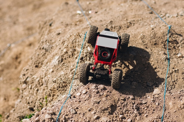 Toy buggy car racing on rally track