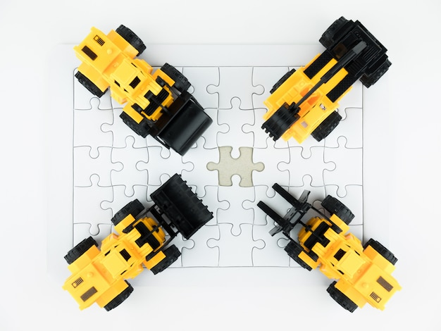 Toy bulldozer, pressure road, truck crane, mechanical digger, forklift and jigsaw puzzle