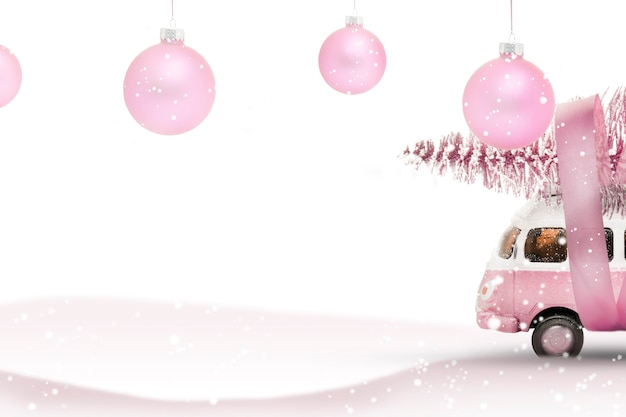 Toy bus car carries a christmas tree from the forest. pink and white colors, winter holiday new year mood.