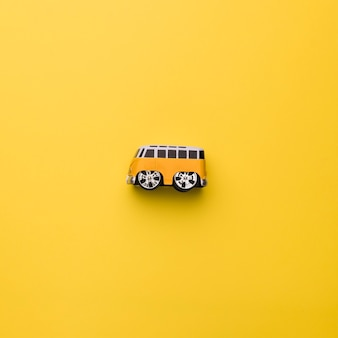 Toy bus on orange background