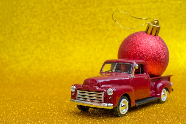 Toy car carries christmas toy ball for holiday