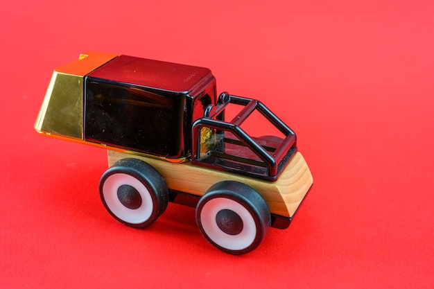 A toy car carries perfume as a gift for christmas.