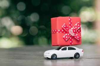 Toy car delivering gift box.
