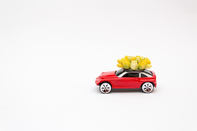 Toy car, flower delivery, valentine's day, copy space