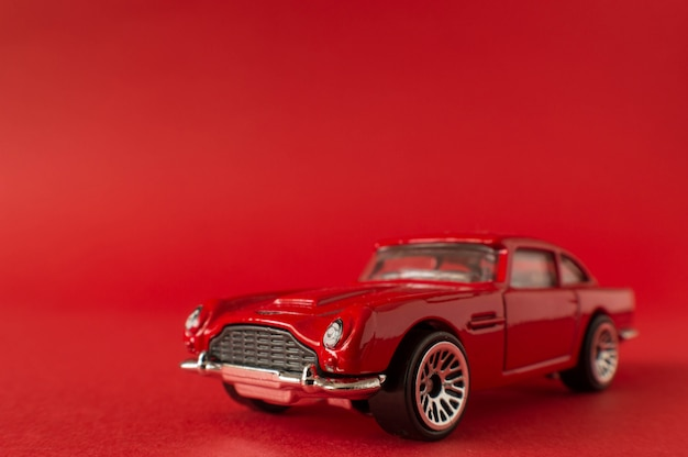 Toy car on red background