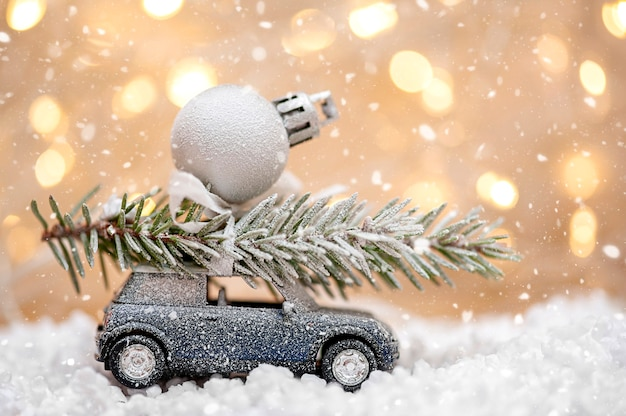 Toy car with christmas tree and decoration winter and snow christmas and new year concept