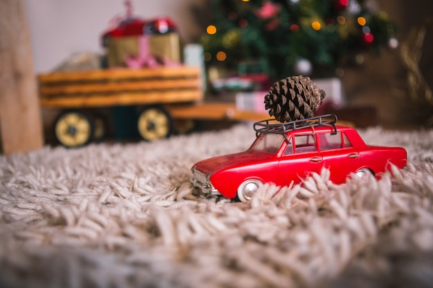 Toy car with a pine cone
