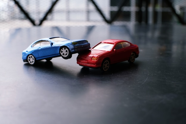 Toy cars crash accident. simulation  red and  blue car