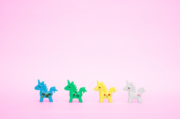 Toy cute unicorn on a pink