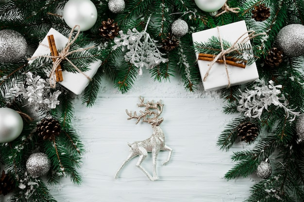 Toy deer near christmas branches