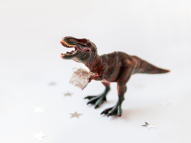 Toy dinosaur with present