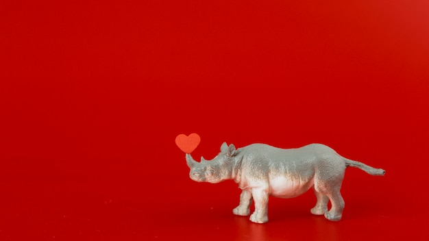 Toy grey rhinoceros with heart