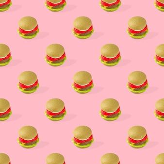 Игрушка гамбургер фаст-фуд бесшовные модели на розовом фоне. нездоровый. не органический