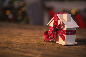 Toy house with a red bow
