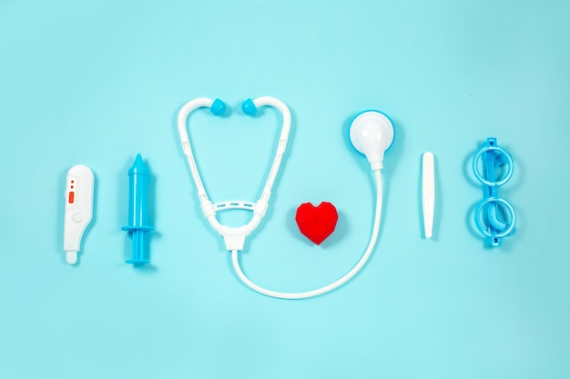 Toy medical devices on a blue. kids medical instruments.