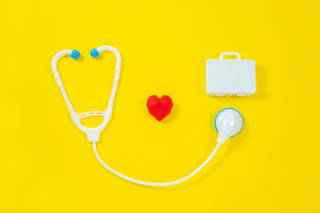 Toy medical devices on a yellow background.