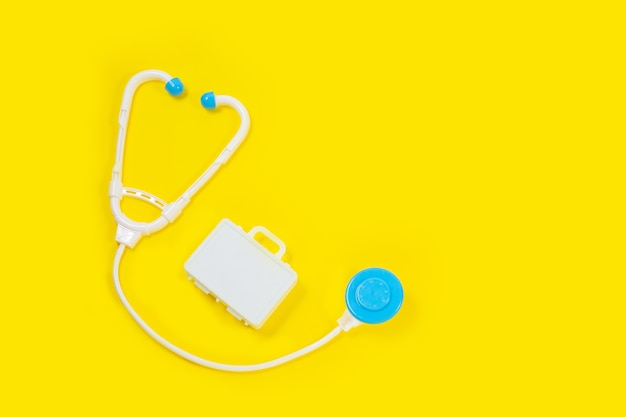 Toy medical devices on a yellow background. Premium Photo