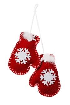 흰색 배경에 고립 된 크리스마스 휴일 장식으로 장난감 장갑