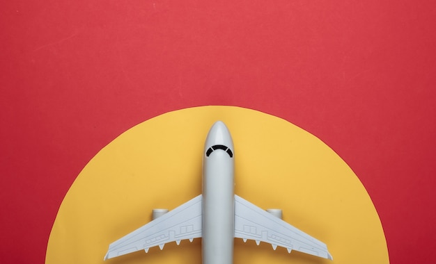 Toy model of plane on red with yellow circle.