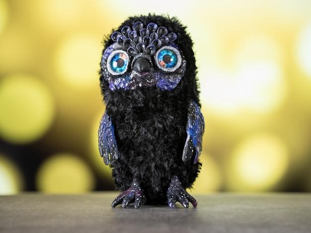 Игрушка сова - вселенная из полимерной глины, сделанная из полимерной глины и плюша в смешанной технике, сидит прямо