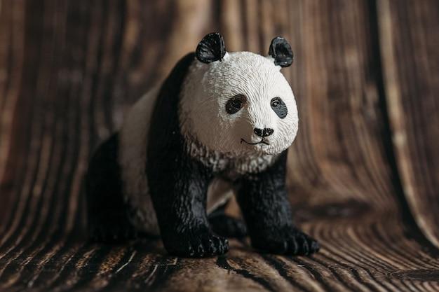 Toy panda figurine on wooden