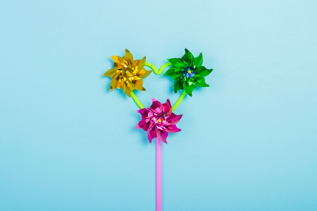 Toy pinwheel on a blue background. flat lay, top view.