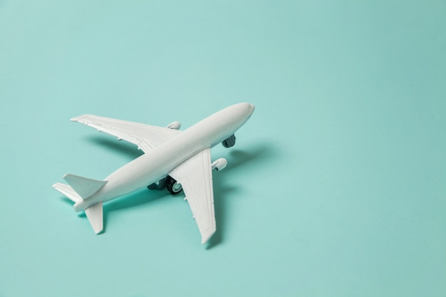 Toy plane on colorful blue background