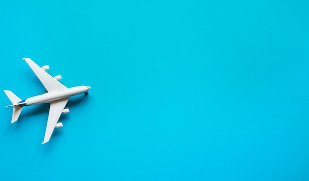 Toy plane on a pastel blue background Premium Photo