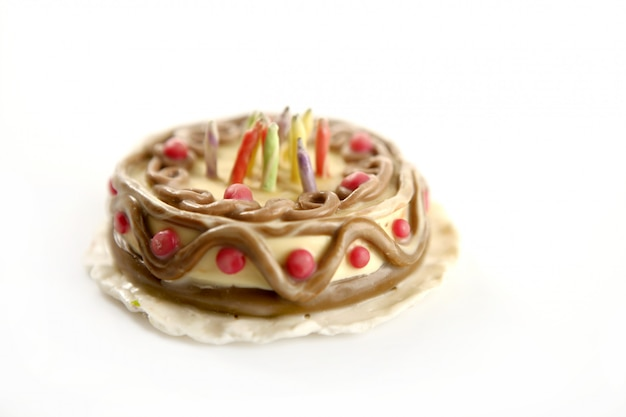 Toy plasticine happy birthday cake over white