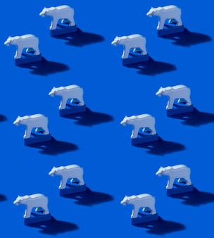 Toy polar bears and blue blocks on ocean blue background. seamless pattern with hard shadows. save the arctic and global warming concept