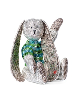 Toy rabbit made of rhinestones and crystals on a white background