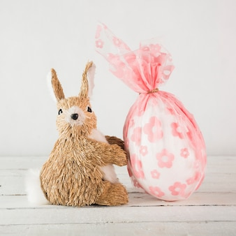 Toy rabbit near egg in pouch
