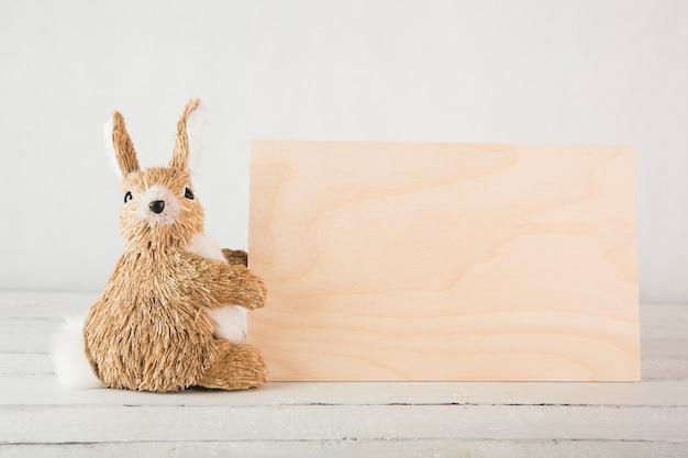 Toy rabbit near wooden board